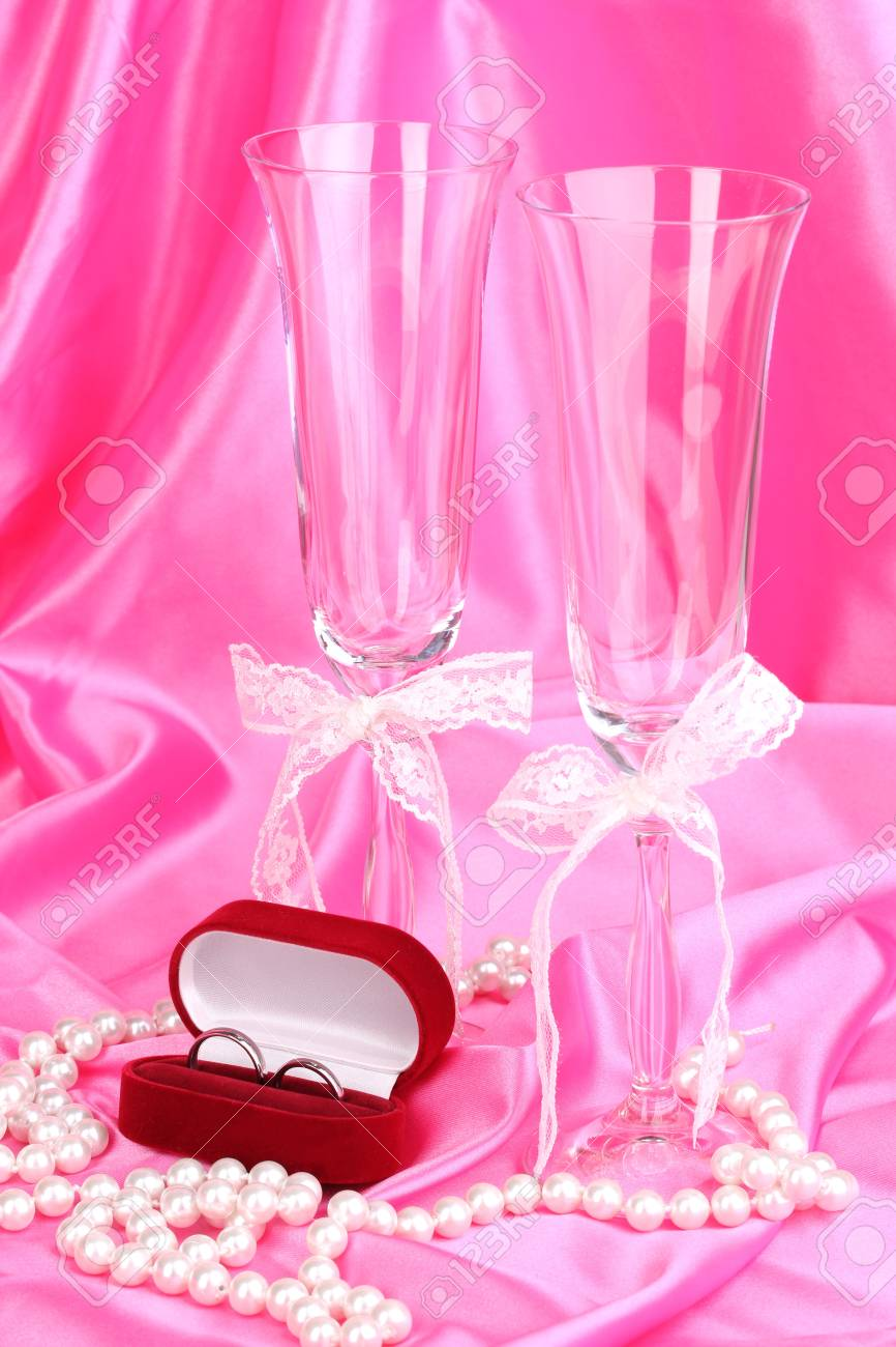 Wedding Accessories On Pink Cloth Background Stock Photo, Picture ...