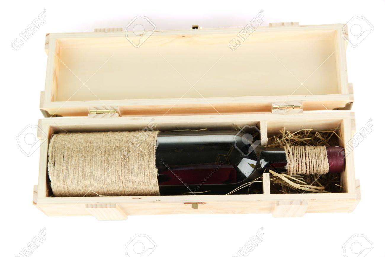 Wine bottle in wooden box, isolated on white Stock Photo - 17063941