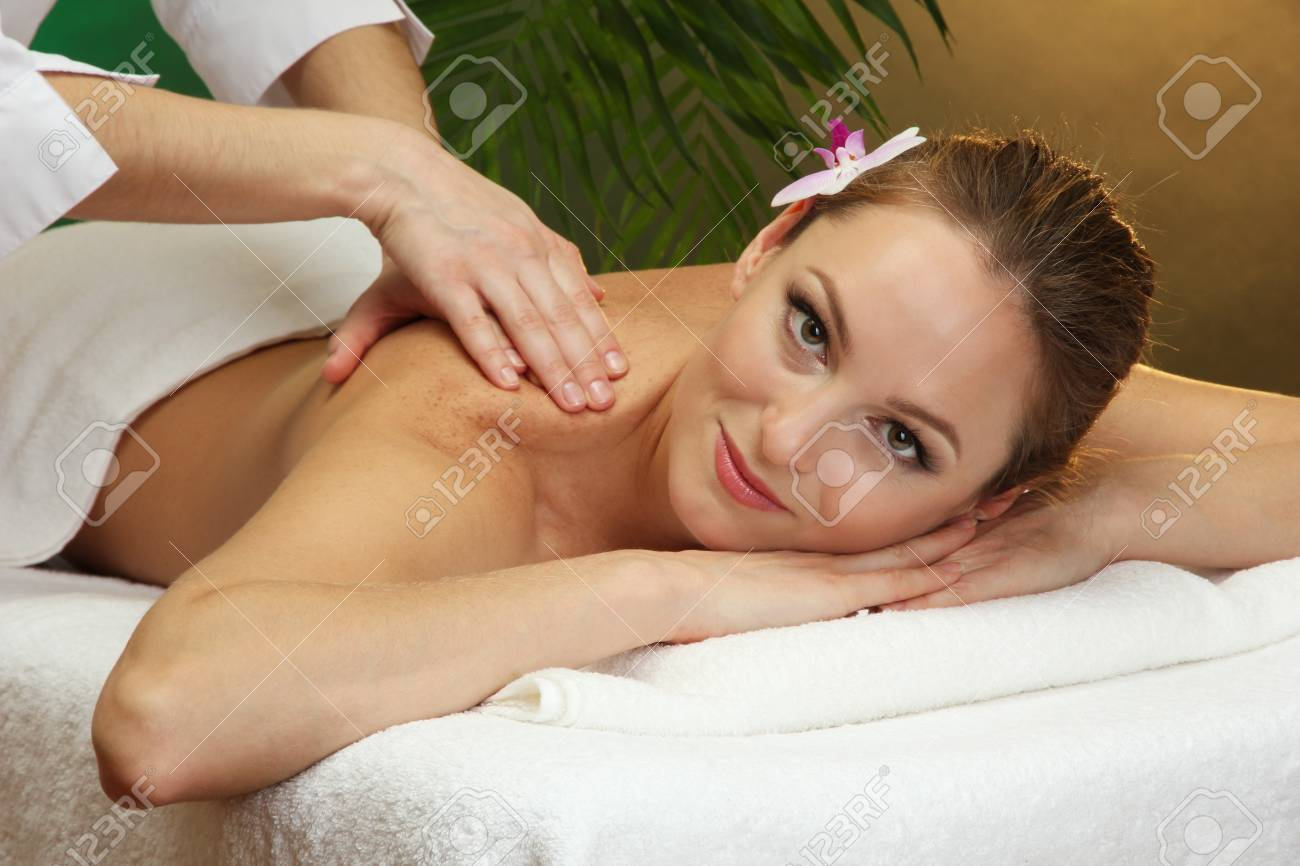 beautiful young woman in spa salon getting massage, on green background Stock Photo - 17282368