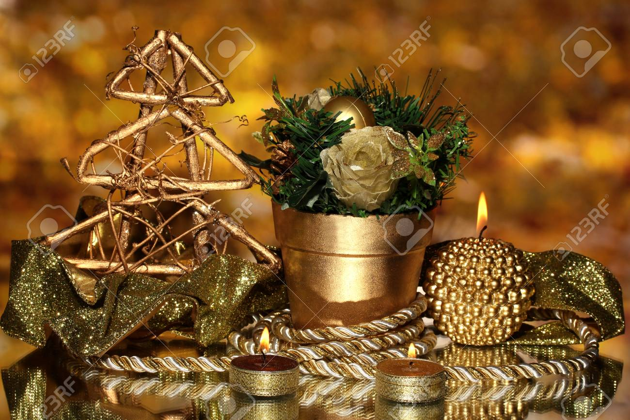 Christmas composition  with candles and decorations in gold color on bright background Stock Photo - 17064394