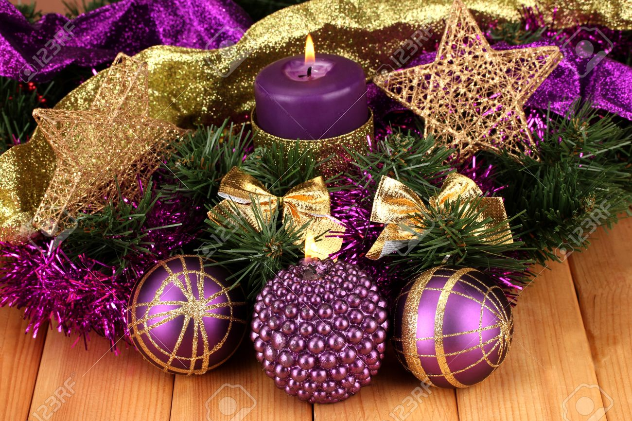 christmas composition with candles and decorations in purple and gold colors on wooden background stock photo