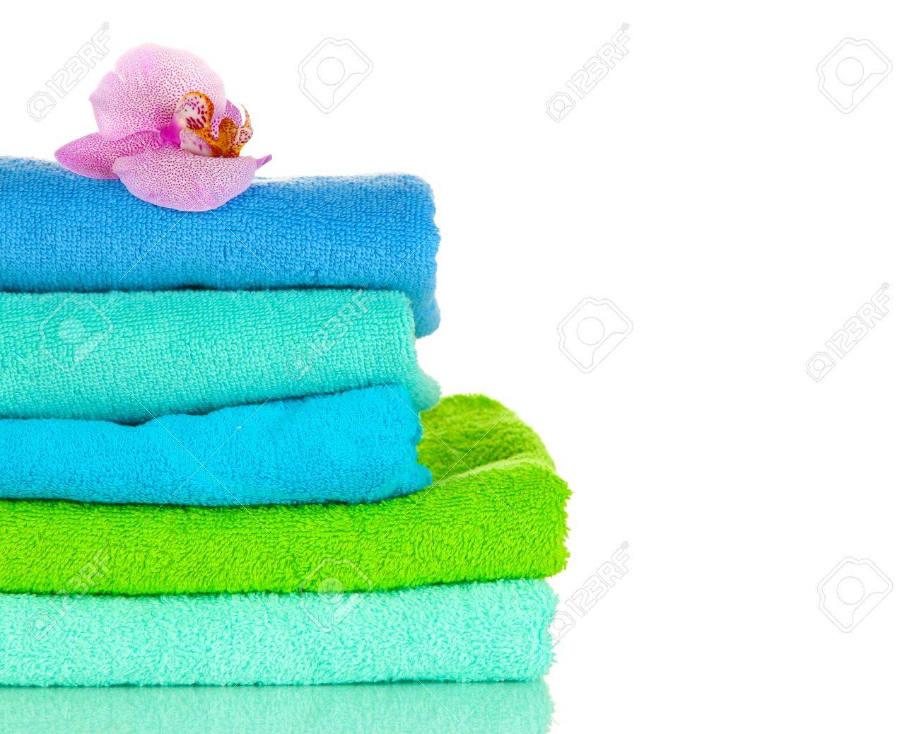Stack of towels with fragrant flower isolated on white Stock Photo - 17063943