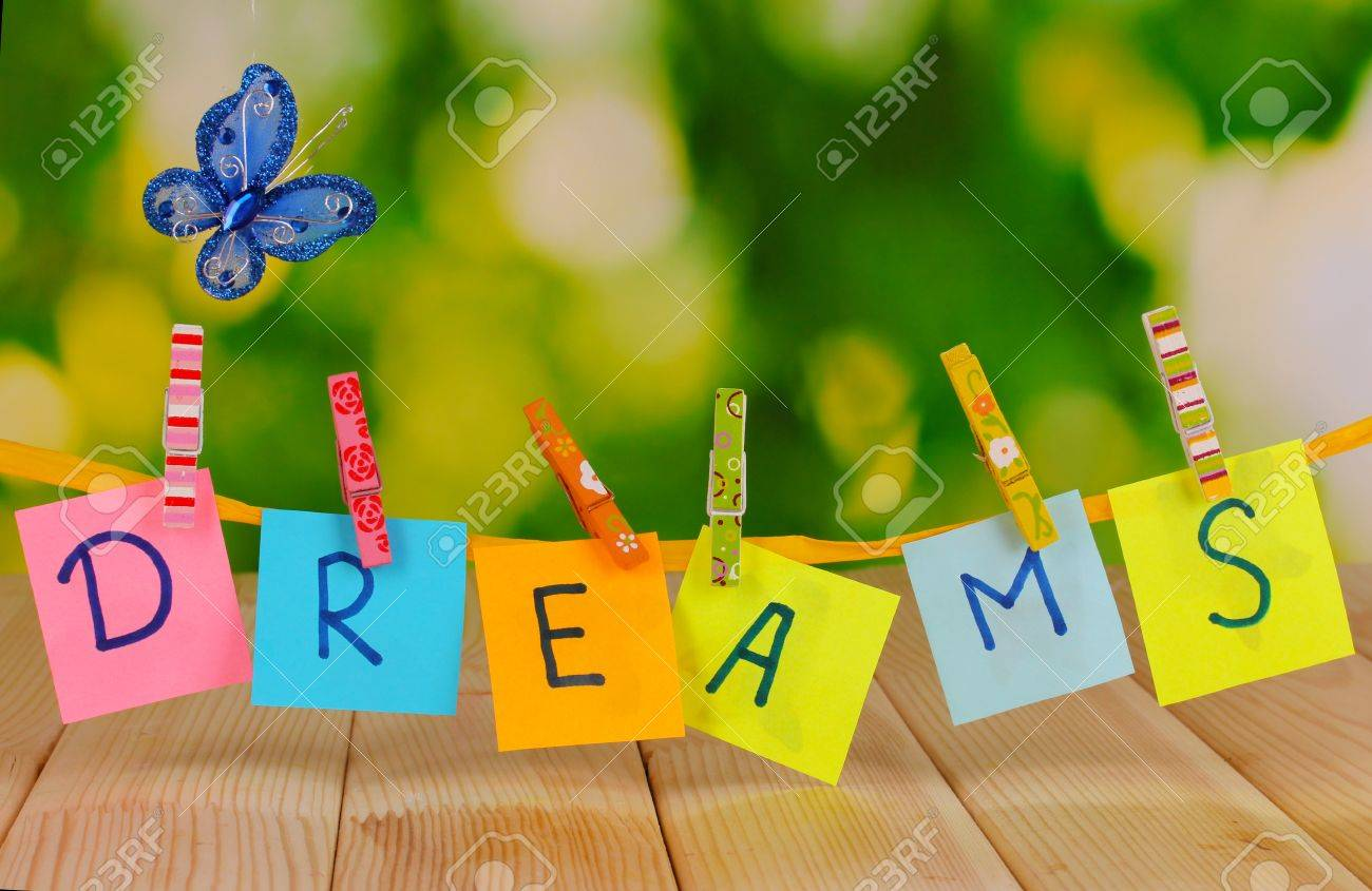 The word Dreams on wooden table on natural background Stock Photo - 17116974