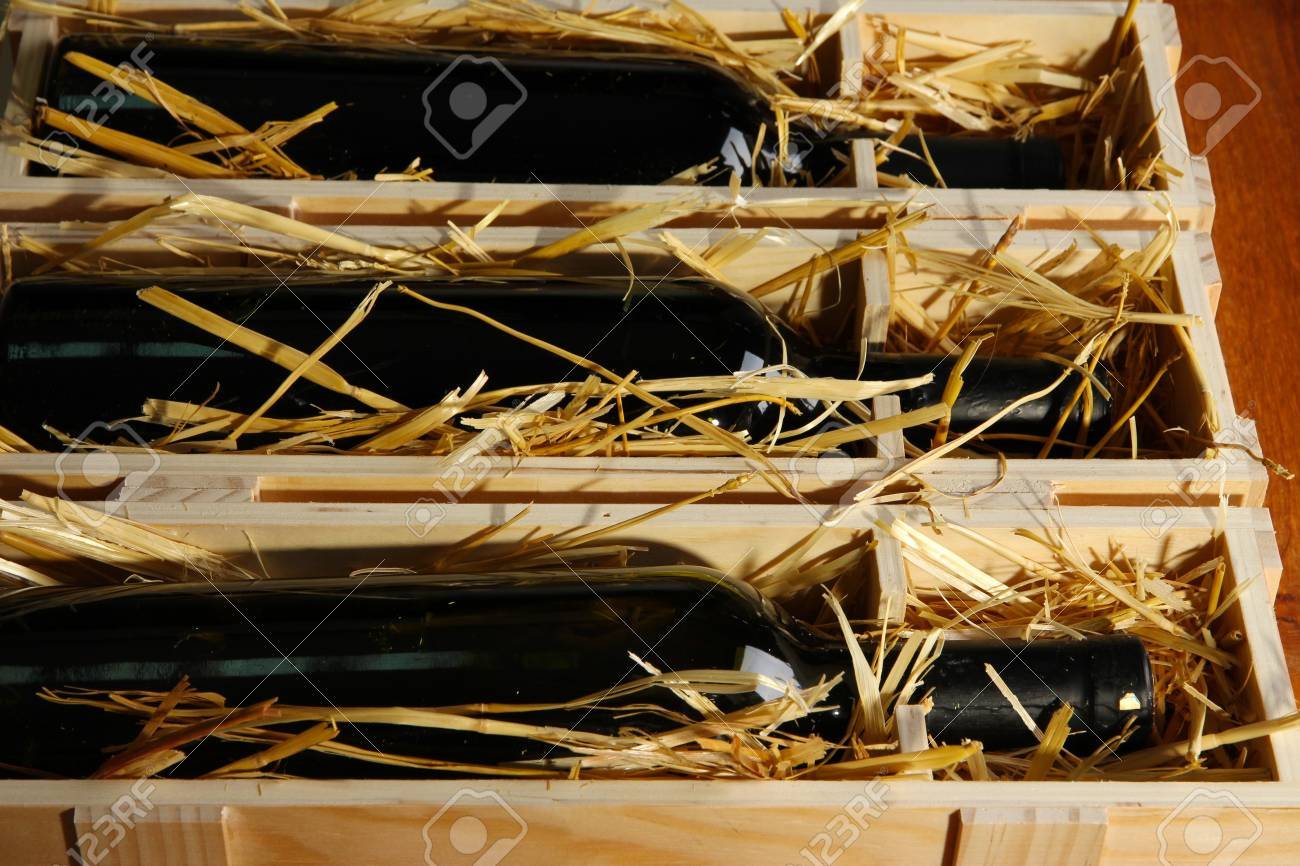 Wooden case with wine bottles close up Stock Photo - 17117931