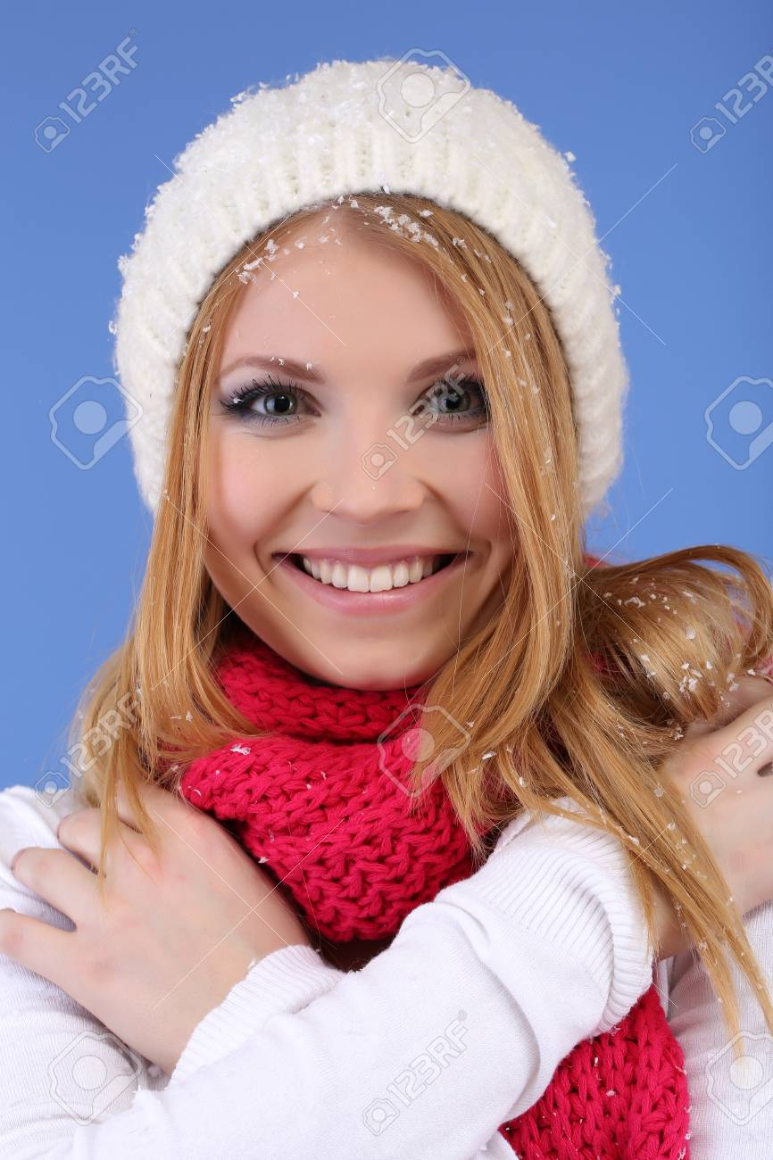 Young beautiful woman with snow on blue background Stock Photo - 17272140