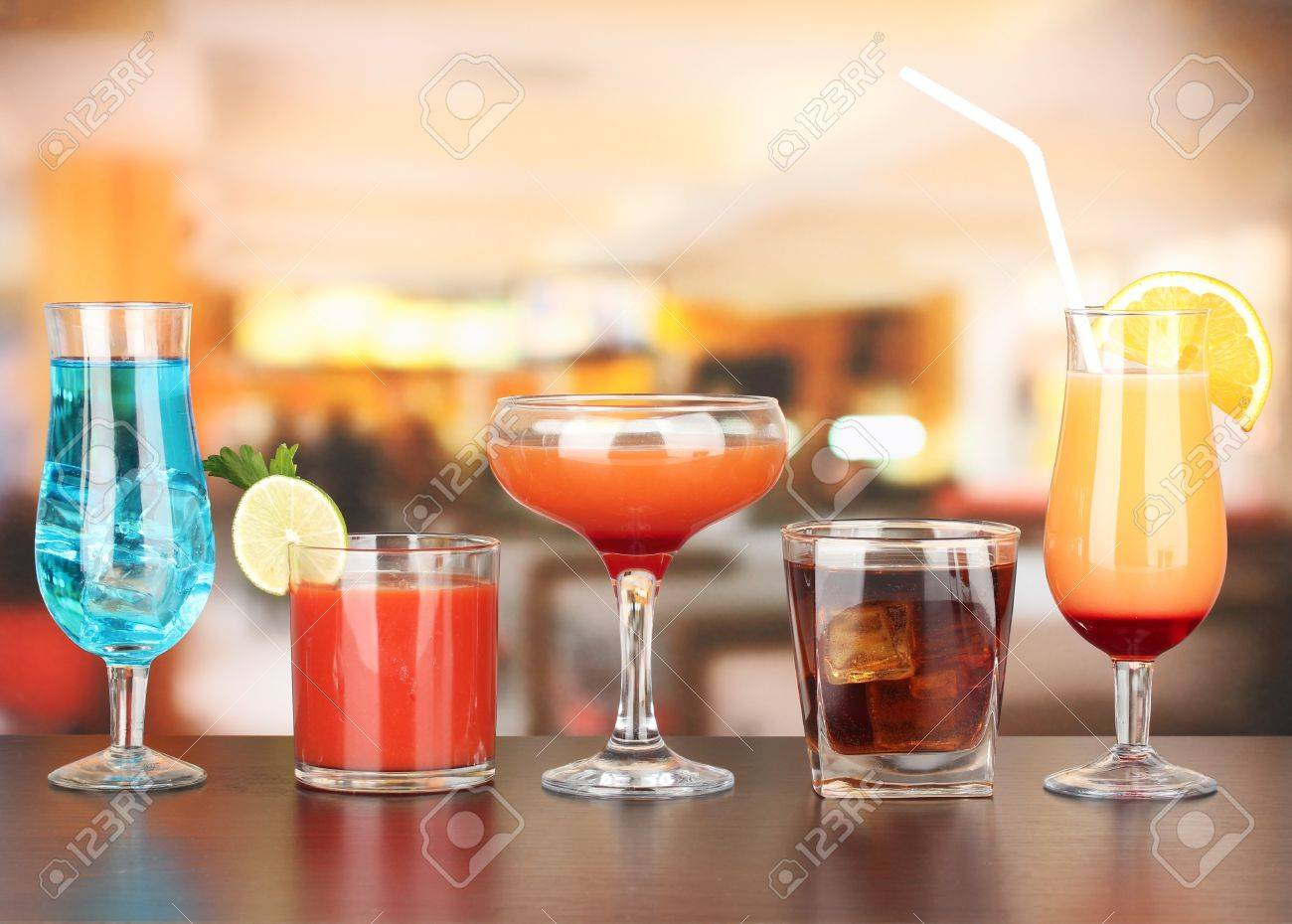 Several glasses of different drinks on bright background Stock Photo - 17116935