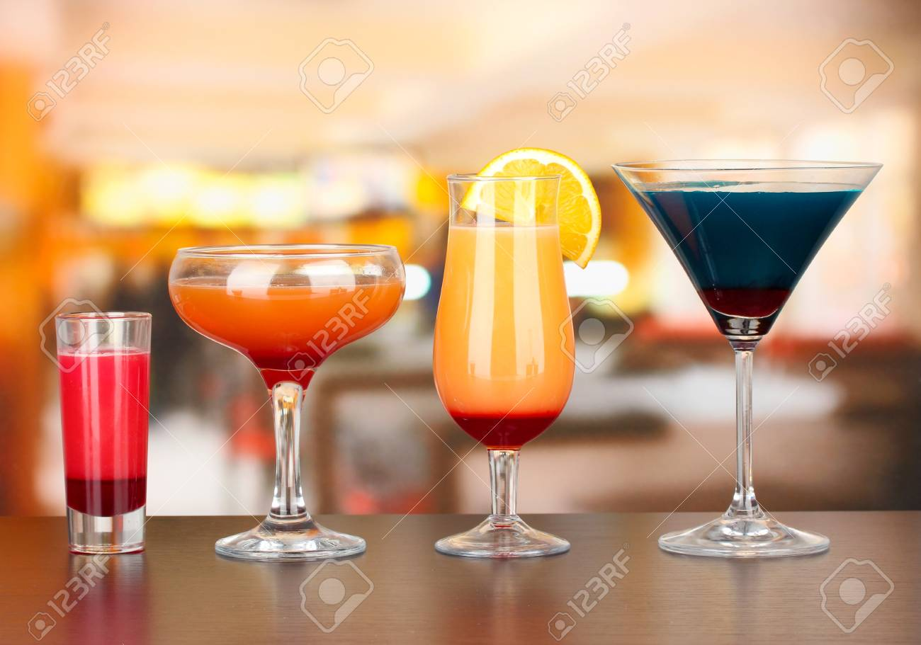 Several glasses of different drinks on bright background Stock Photo - 17112088