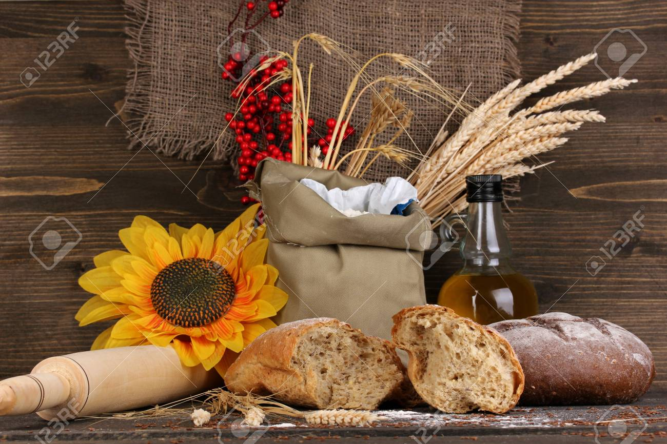Rye bread on wooden table on wooden background Stock Photo - 17144417