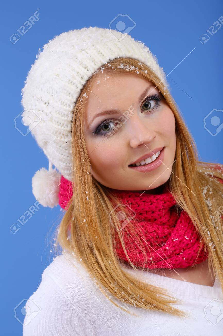 Young beautiful woman with snow on blue background Stock Photo - 17281494
