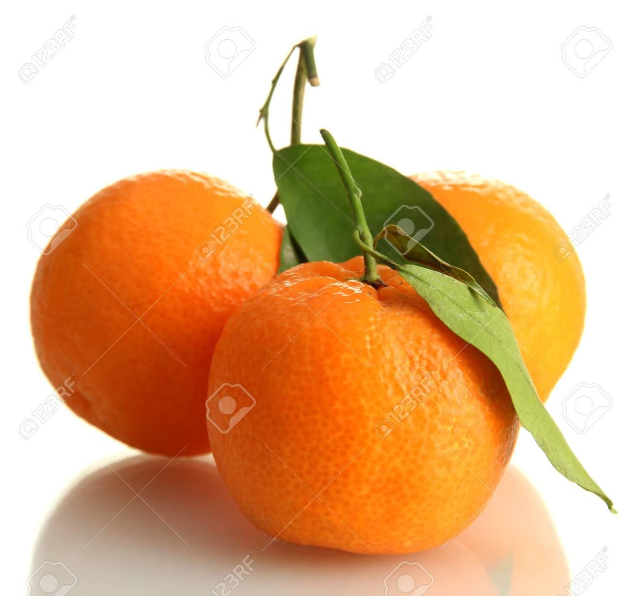 Ripe sweet tangerines with leaves, isolated on white Stock Photo - 17139816