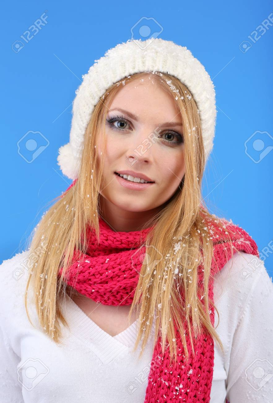 Young beautiful woman with snow on blue background Stock Photo - 17281353