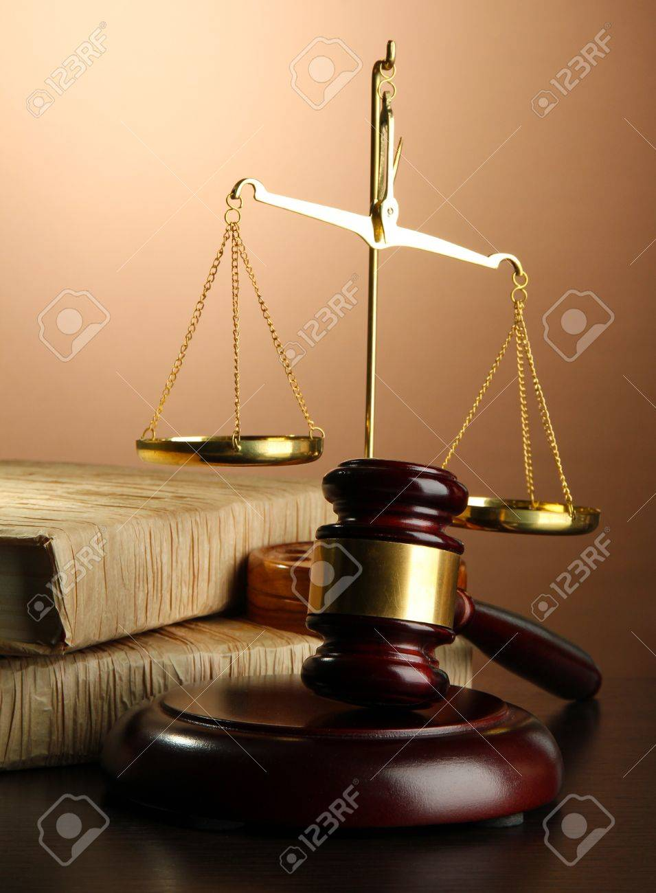 Golden scales of justice, gavel and books on brown background Stock Photo - 17256788