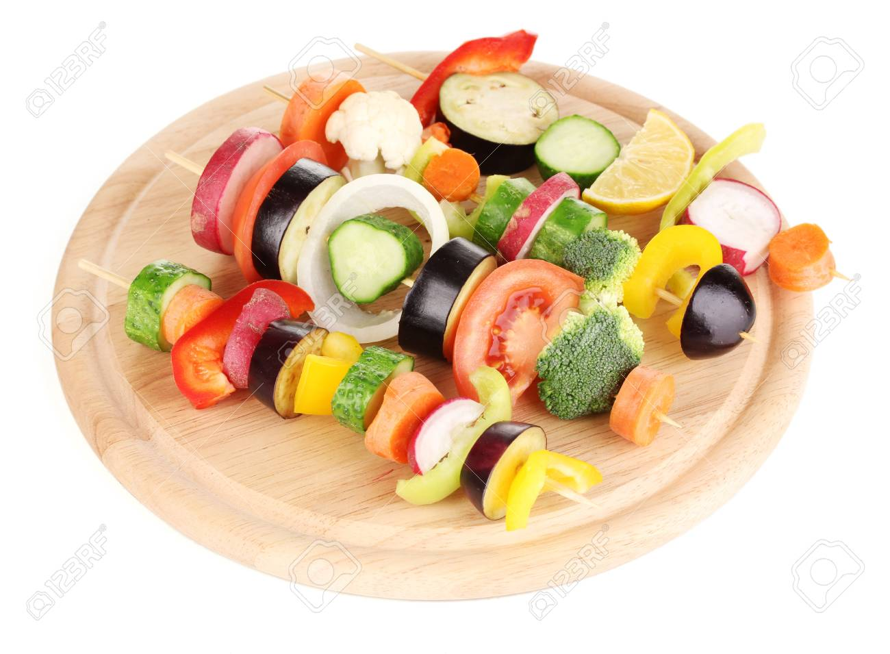 Sliced vegetables on wooden picks isolated on white Stock Photo - 17263576