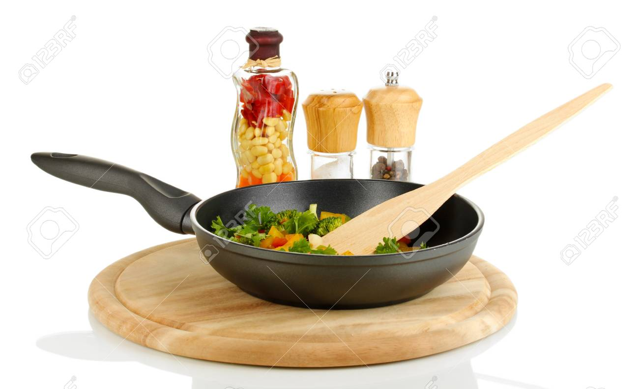 Sliced fresh vegetables in pan with spices isolated on white Stock Photo - 17263398
