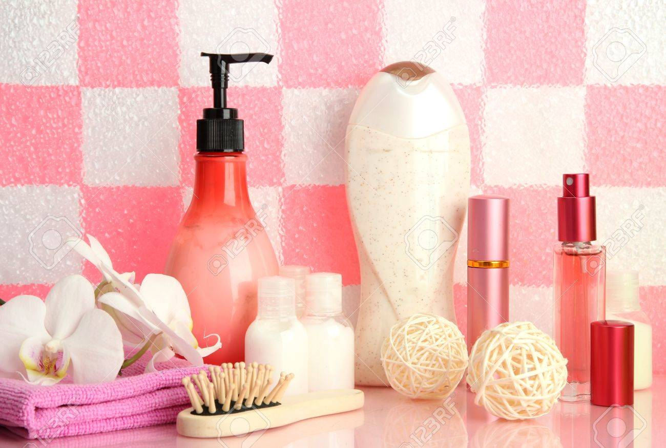 Bath accessories on shelf in bathroom on pink tile wall background Stock Photo - 17263922