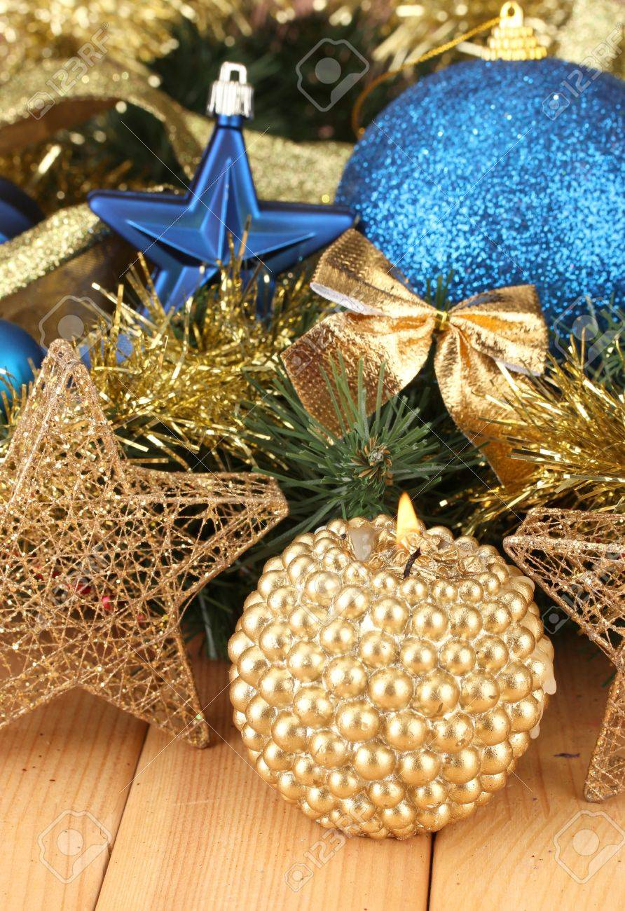 Blue and gold christmas decorations - Christmas Composition With Candles And Decorations In Blue And Gold Colors On Wooden Background Stock Photo