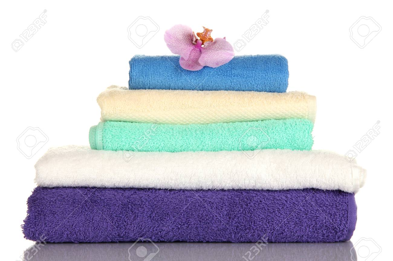 Stack of towels with fragrant flower isolated on white Stock Photo - 17263967