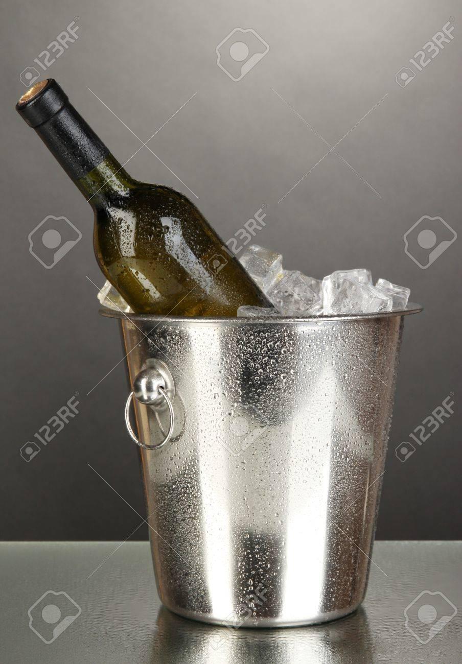 Bottle of wine in ice bucket on black background Stock Photo - 17264114