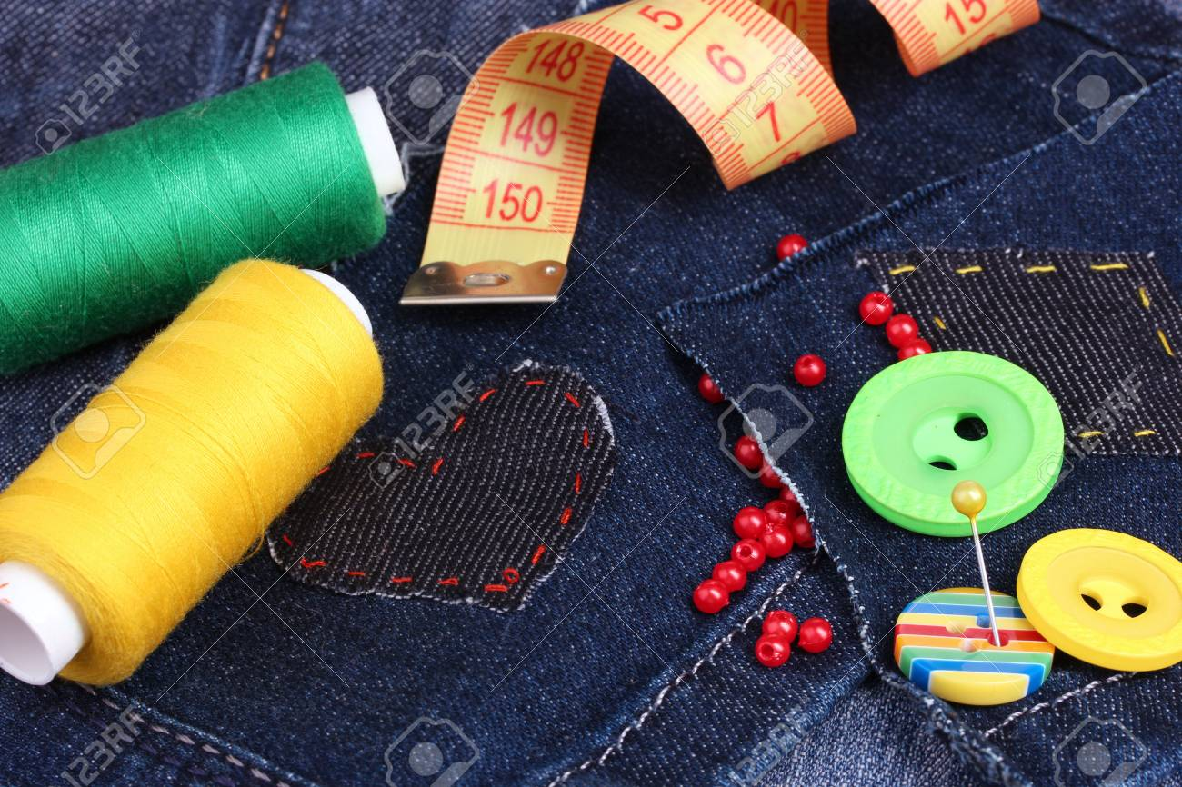Heart-shaped patch on jeans with threads and buttons closeup Stock Photo - 17292714