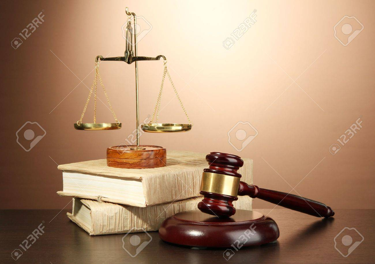 Golden scales of justice, gavel and books on brown background Stock Photo - 17291823