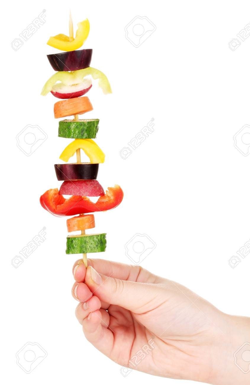 Sliced vegetables on wooden pick holding in hand isolated on white Stock Photo - 17289970