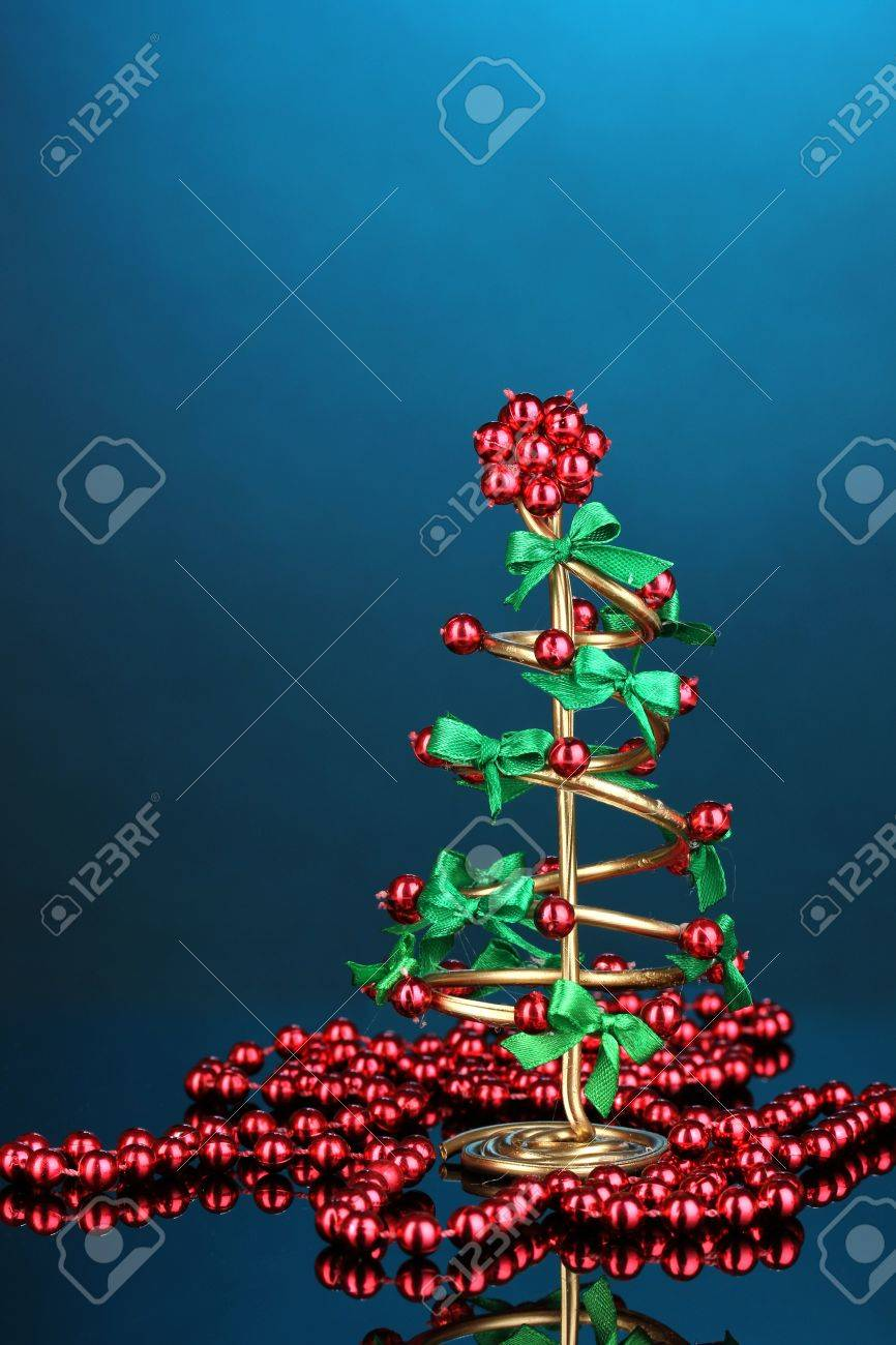 Wire Christmas tree with beads on blue background Stock Photo - 17292247