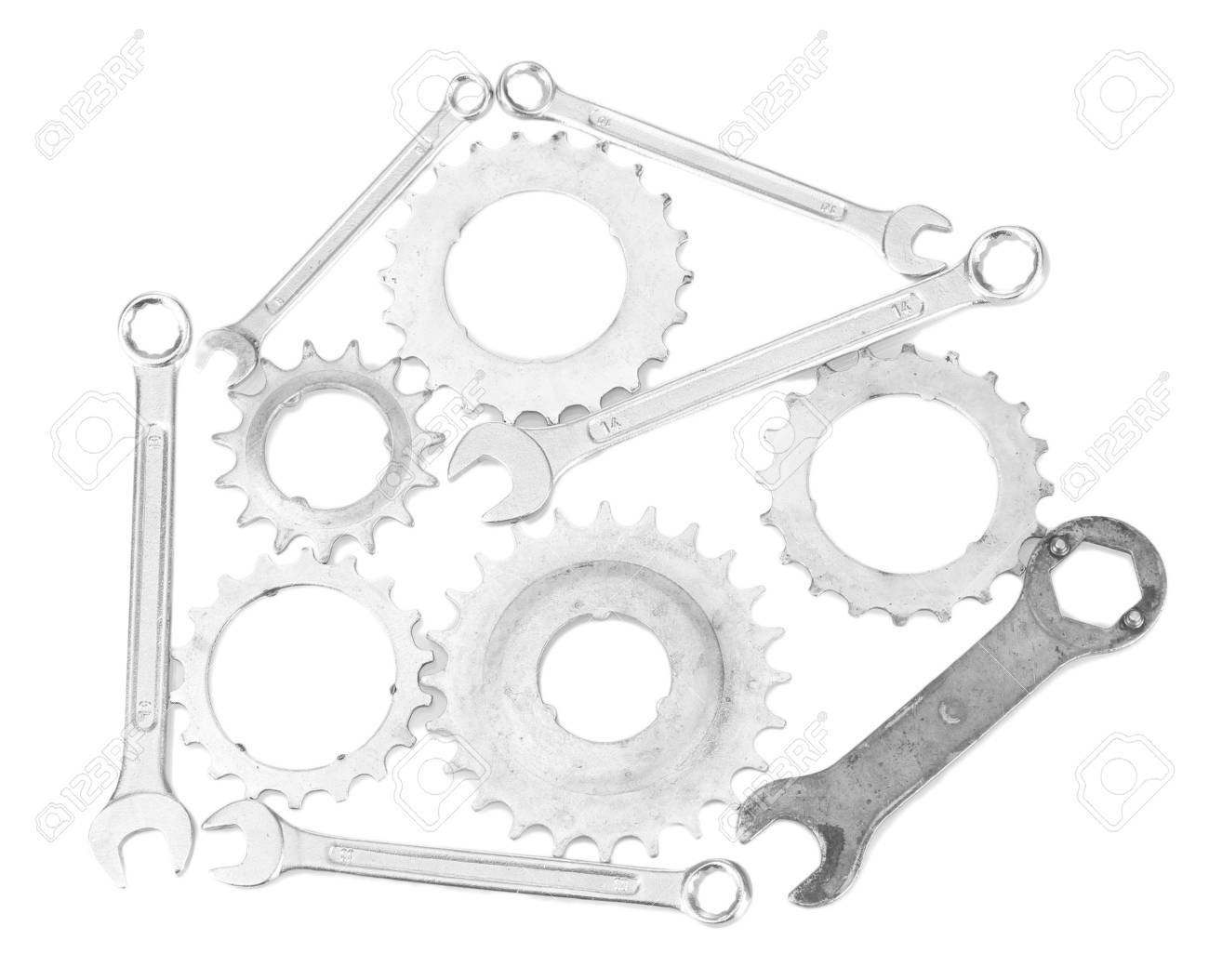 Metal cogwheels and spanners isolated on black Stock Photo - 17348646