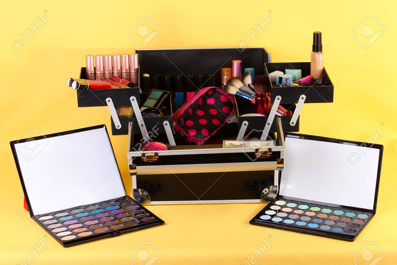 open case with cosmetics on yellow background Stock Photo - 17348441
