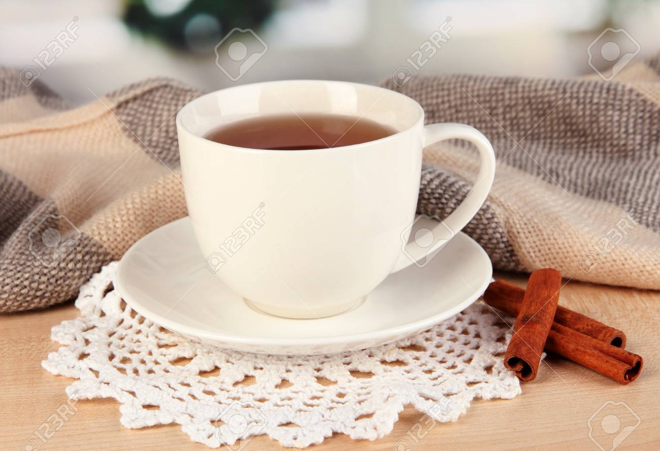 cup of tea with scarf on table in room Stock Photo - 17348432