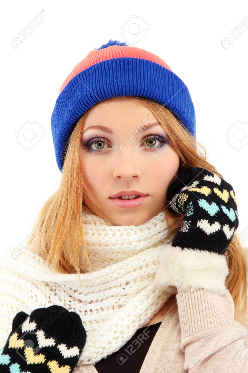 Young beautiful woman wearing winter clothing, isolated on white Stock Photo - 17544497