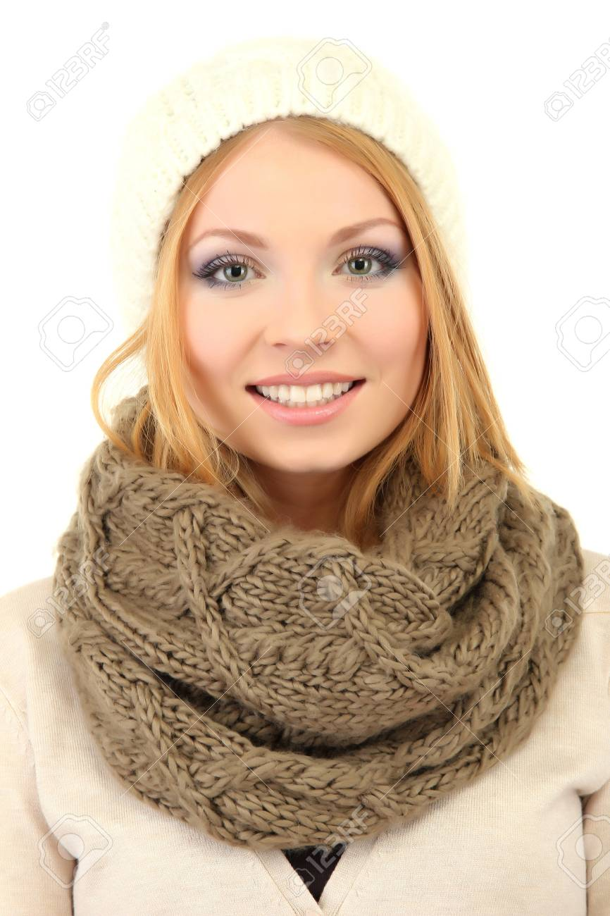 Young beautiful woman wearing winter clothing, isolated on white Stock Photo - 17544491