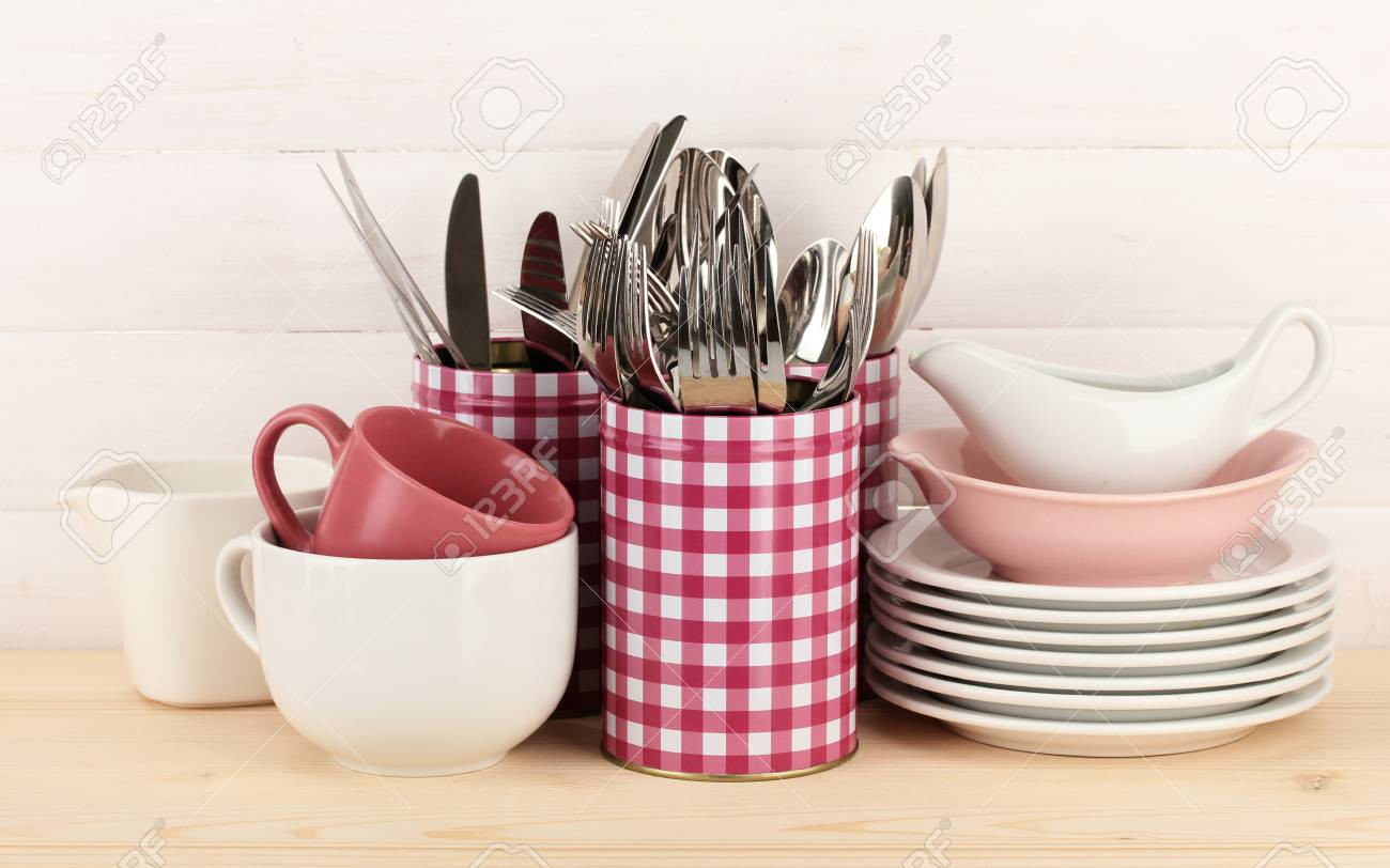 Cups, bowls nd other utensils in metal containers isolated on light background Stock Photo - 17458845