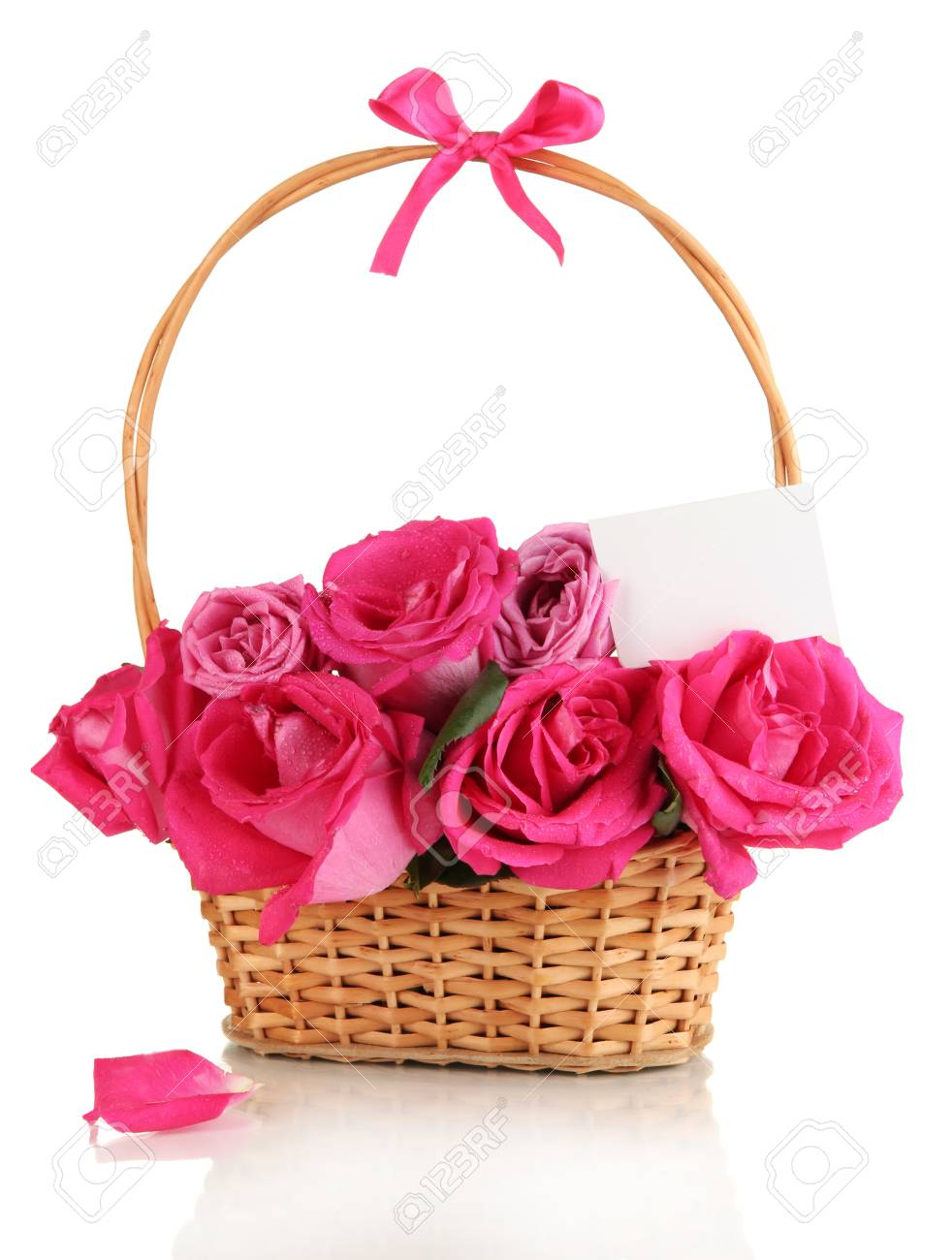 Beautiful pink roses in basket isolated on white Stock Photo - 17458756