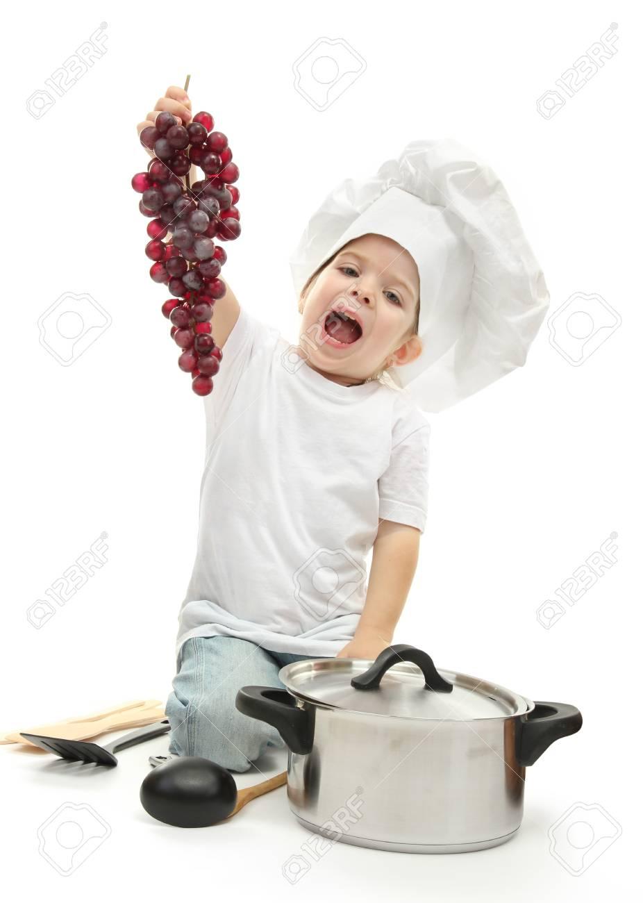 Petite Fille Dans Le Chapeau De Chef Avec Accessoires De Cuisine Ang