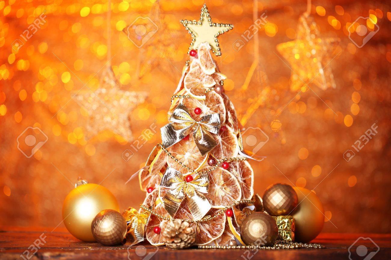 Beautiful Christmas Tree Of Dry Lemons With Decor On Orange Stock