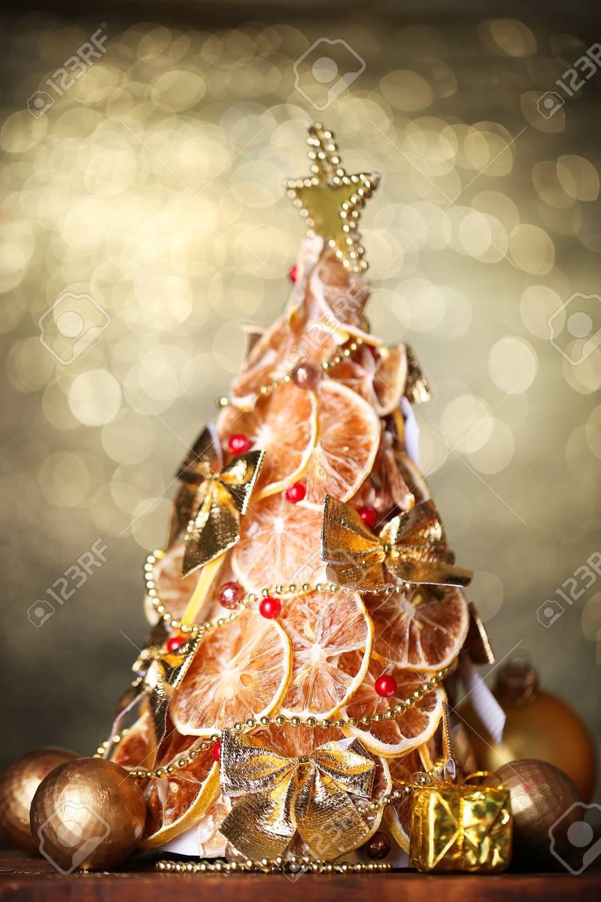 Beautiful Christmas Tree Of Dry Lemons With Decor On Shine Stock