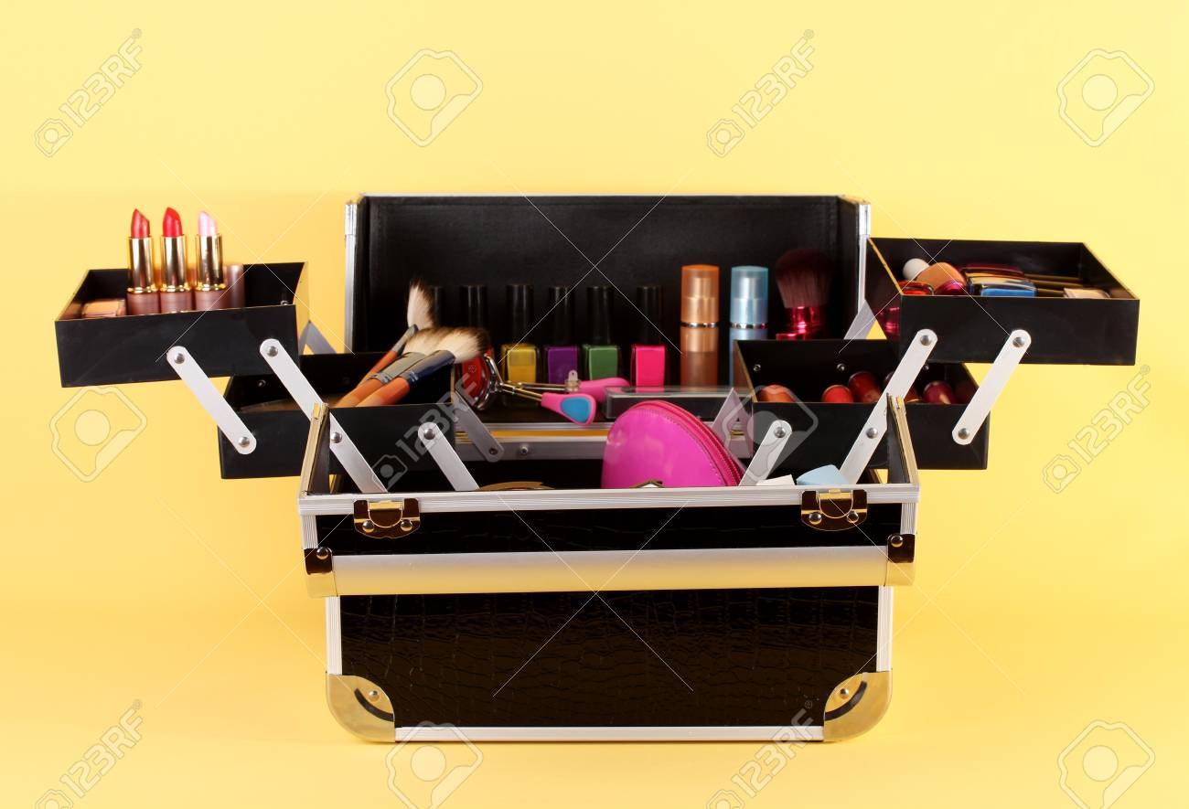 open case with cosmetics on yellow background Stock Photo - 17674700