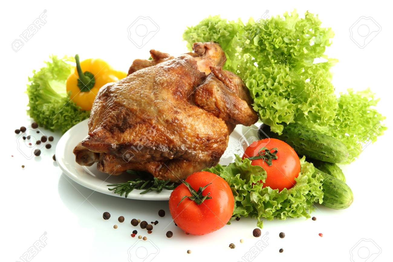 Tasty whole roasted chicken on plate with vegetables, isolated on white Stock Photo - 17682099