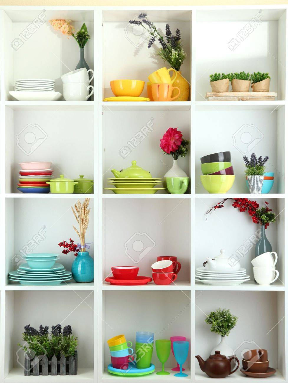 Beautiful white shelves with tableware and decor - 17663269