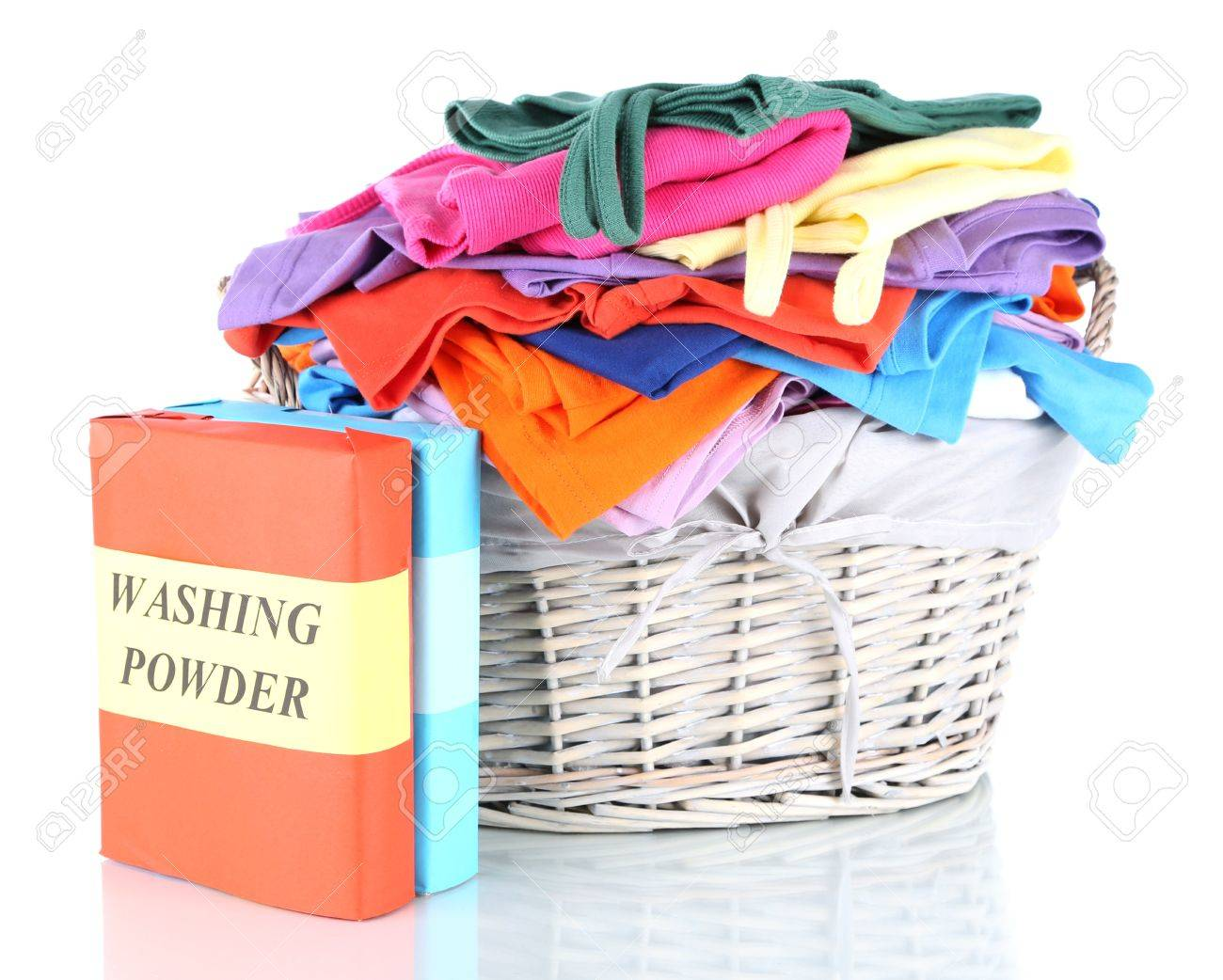 Clothes with washing powder in wooden basket isolated on white Stock Photo - 17663115