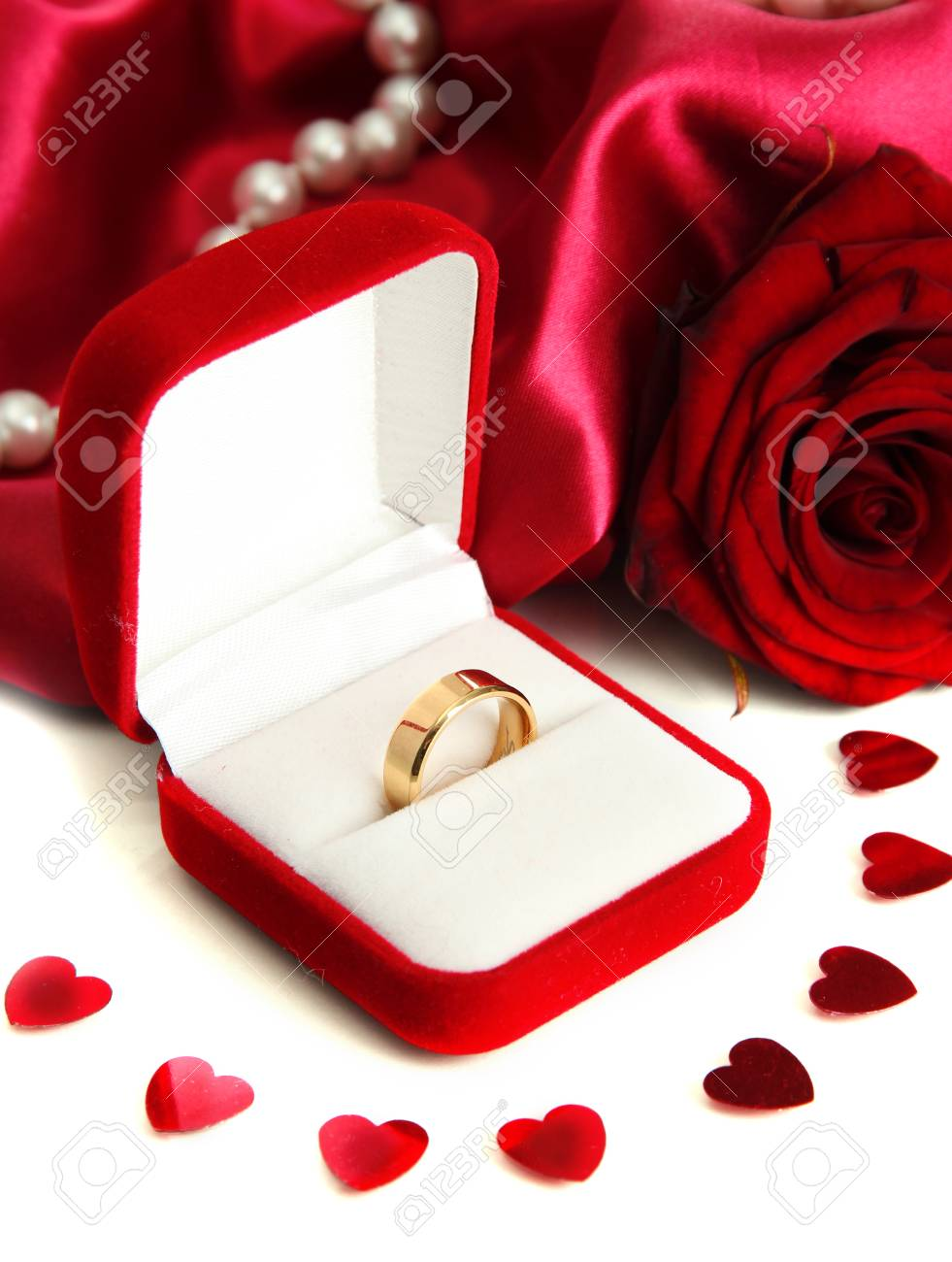 b0433666c Beautiful box with wedding ring and rose on red silk background Stock Photo  - 17704463