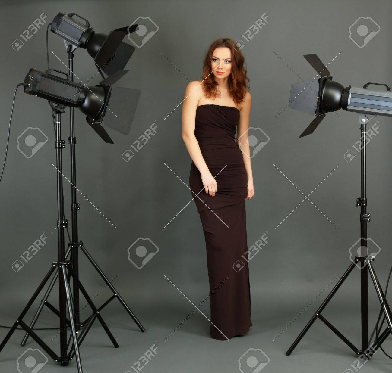 Beautiful professional female model resting between shots in photography studio shoot set-up Stock Photo - 18040022