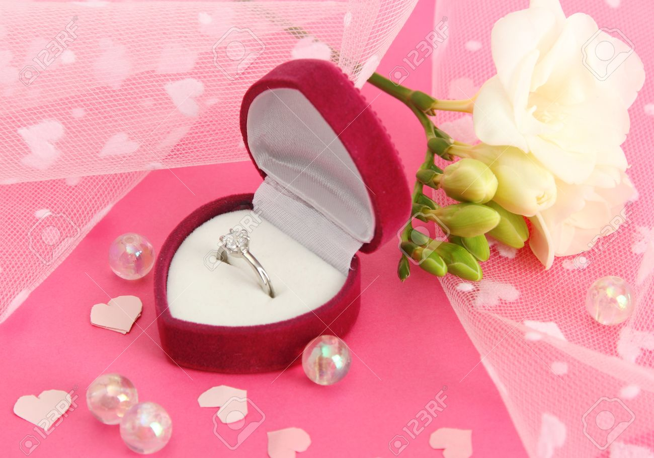 Beautiful Box With Wedding Ring And Flower On Pink Background Stock ...