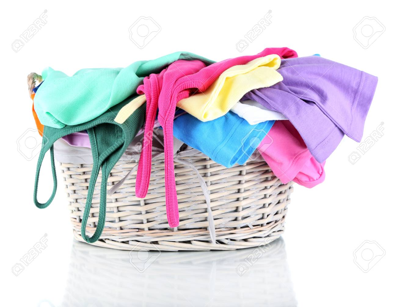 Clothes in wooden basket isolated on white Stock Photo - 17768999
