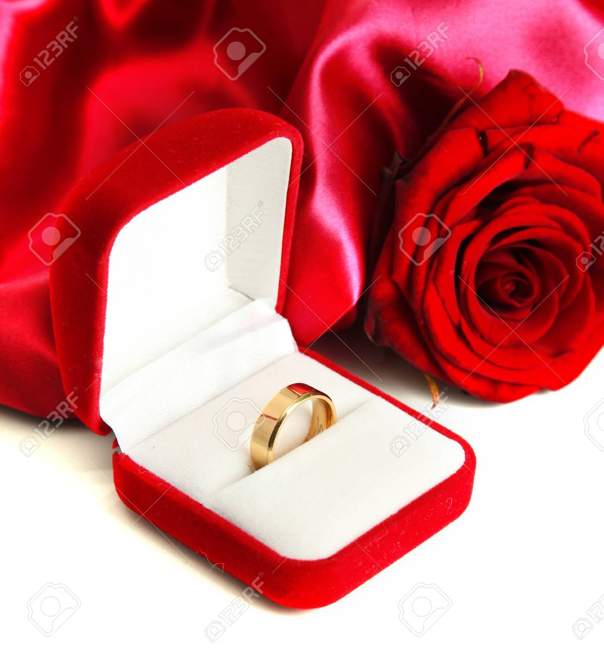 d082a8407 Beautiful box with wedding ring and rose on red silk background Stock Photo  - 17768954