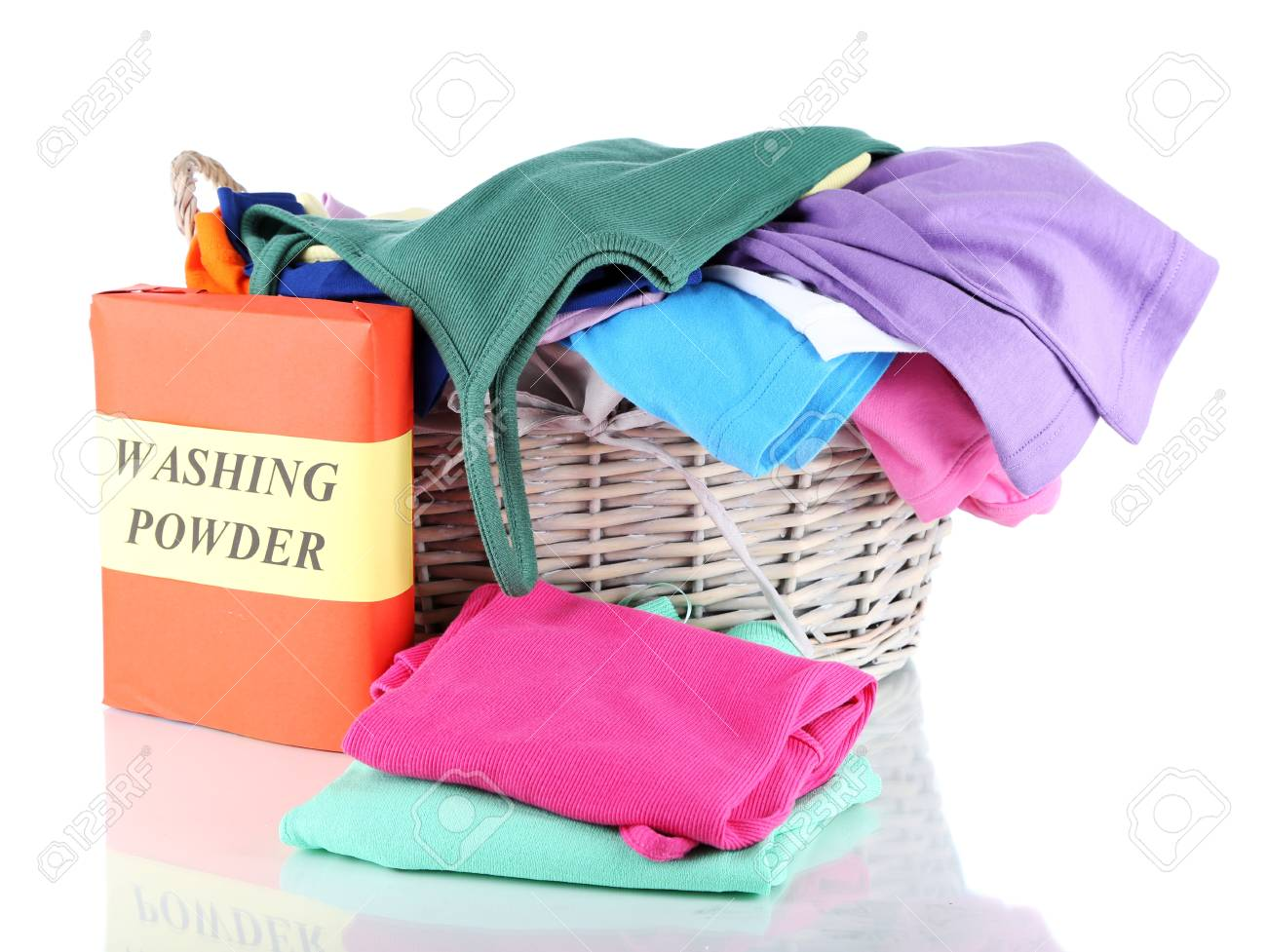 Clothes with washing powder in wooden basket isolated on white Stock Photo - 17771459