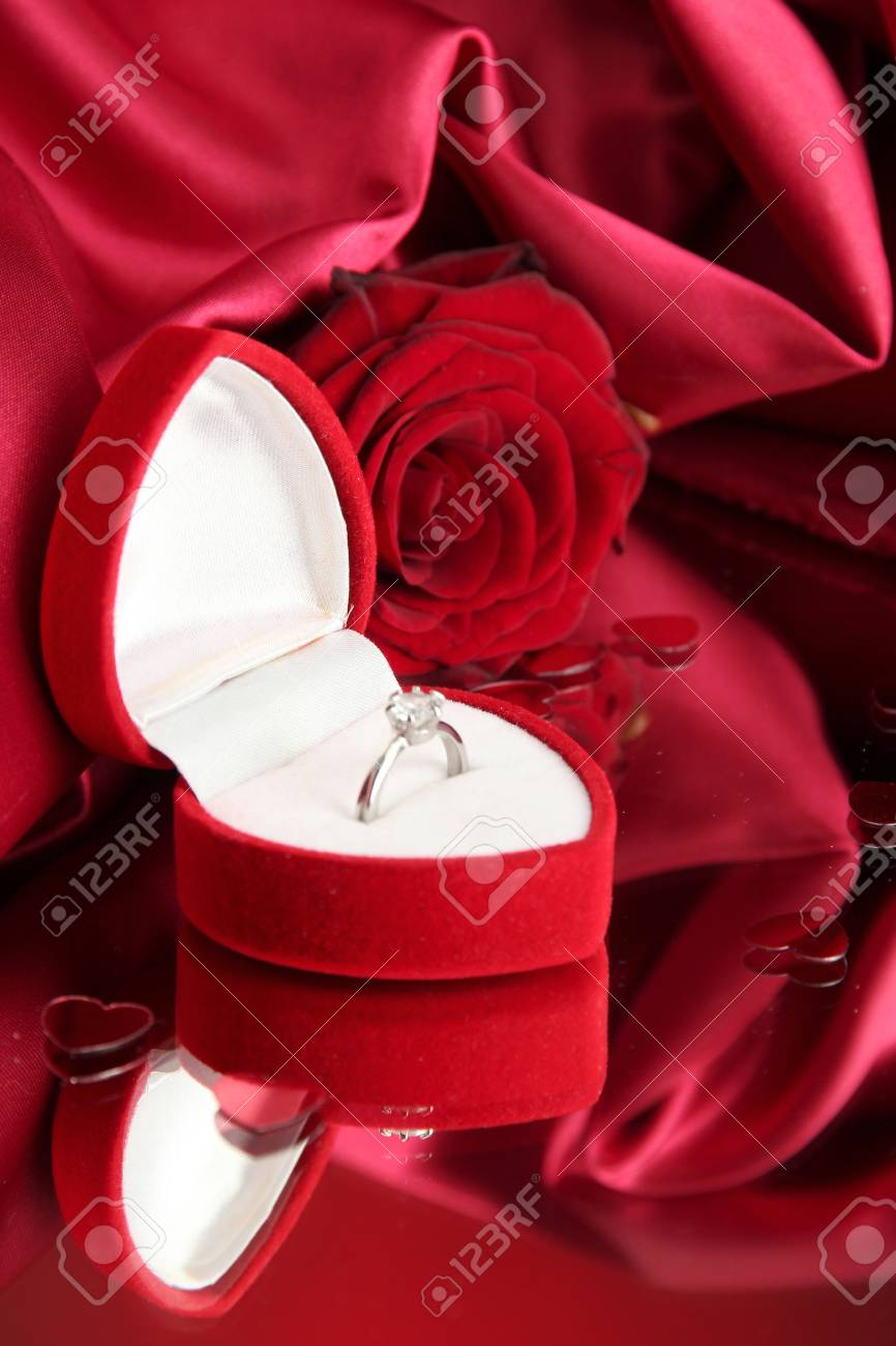 dad7d837c Beautiful box with wedding ring and rose on red silk background Stock Photo  - 17823962