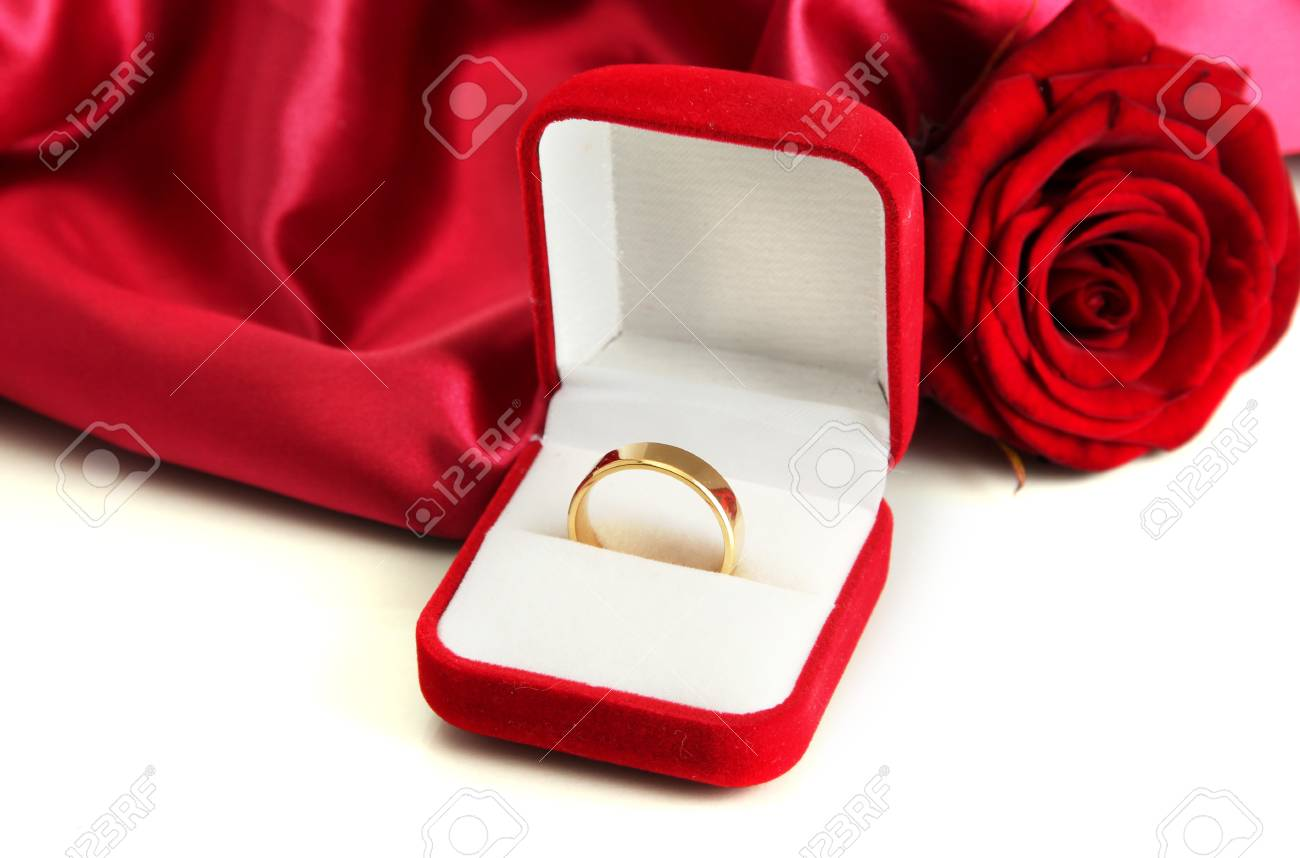9b6c4bca1 Beautiful box with wedding ring and rose on red silk background Stock Photo  - 17943534