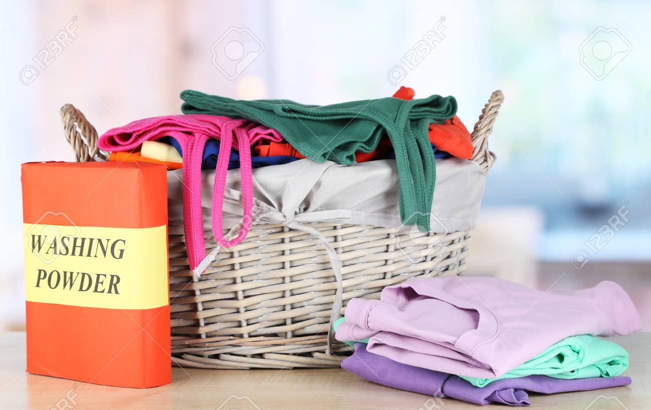 Clothes in wooden basket on table in room Stock Photo - 18041586