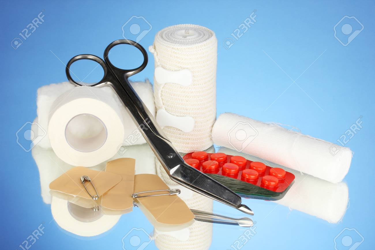 First aid kit for bandaging on blue background Stock Photo - 18130779
